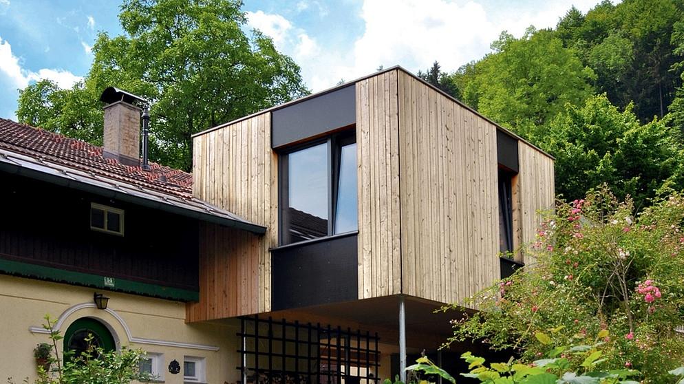erweiterung haus auf stelzen idee e immagini di design per la casa. Black Bedroom Furniture Sets. Home Design Ideas