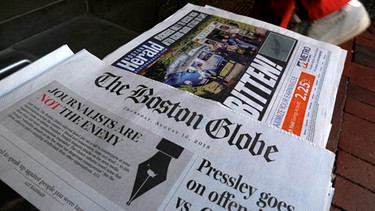 "Frontpage Boston Globe ""We are not the enemy"". 
